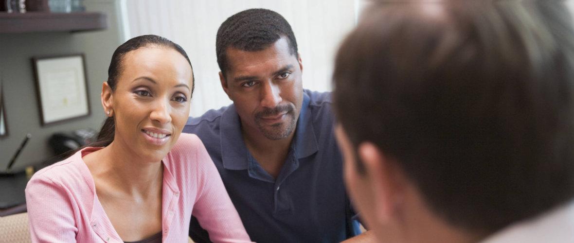 elderly couple listening to a therapist